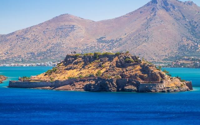 Spinalonga island at turquise water of Crete